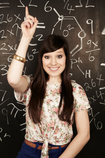141476451-portrait-of-woman-raising-her-hand-in-class-gettyimages